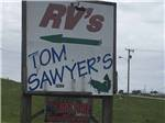 View larger image of Couple sitting on the water at TOM SAWYERS RV PARK image #7