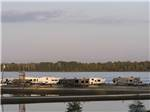 View larger image of Couple relaxing on the water at TOM SAWYERS RV PARK image #8