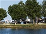 View larger image of Couple sitting on bench watching boats pass in the river at TOM SAWYERS RV PARK image #9
