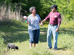 View larger image of Couple walking dog at TOM SAWYERS RV PARK image #12