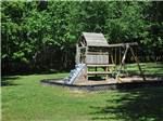 View larger image of Playground with swing set at MEMPHIS GRACELAND RV PARK  CAMPGROUND image #4