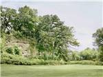 View larger image of Bench with a view of golf course  at THE OLD BARN RESORT image #6