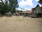 View larger image of Playground with swing set at BIRMINGHAM SOUTH RV PARK image #9