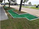 View larger image of Orange truck parked behind RV unit at TRADERS VILLAGE RV PARK image #11