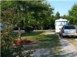 View larger image of A motorhome in one of the RV sites at BARNYARD RV PARK image #3