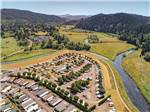 View larger image of Aerial view of park and surrounding hills at BROOKHOLLOW RV PARK image #2