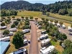 View larger image of Aerial view of RVs parked in sites at BROOKHOLLOW RV PARK image #7