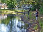 View larger image of Kids fishing at the lake at COMPASS RV PARK image #6