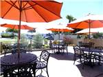 View larger image of Patio area with picnic tables at PISMO SANDS RV PARK image #4