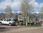 View larger image of Trailers camping at snowcapped mountains at GRAPE CREEK RV PARK CAMPGROUND  CABINS image #4