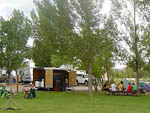 View larger image of Trailers and people sitting at picnic table at THOUSAND LAKES RV PARK  CAMPGROUND image #4