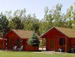 View larger image of Log Cabins with decks at THOUSAND LAKES RV PARK  CAMPGROUND image #5