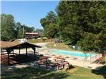 View larger image of Overlooking the fenced in pool area at SOARING EAGLE CAMPGROUND  RV PARK image #2