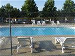 View larger image of Swimming pool with outdoor seating at FORT CHISWELL RV PARK image #2