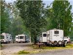 View larger image of Big rig towing a dinghy on a gravel road at RIVERS EDGE RV PARK  CAMPGROUND image #5