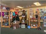 View larger image of Woman reading at a picnic table at RIVERS EDGE RV PARK  CAMPGROUND image #8