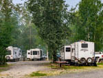 View larger image of Slideouts parked in gravel sites at RIVERS EDGE RV PARK  CAMPGROUND image #10