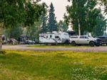 View larger image of Trailer and pickup in a gravel site at RIVERS EDGE RV PARK  CAMPGROUND image #11