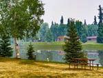 View larger image of Man fishing from the lake shore at RIVERS EDGE RV PARK  CAMPGROUND image #12