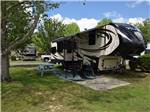 View larger image of Wooden boat dock along large lake with RVs on opposite side at SUNSET KING LAKE RV RESORT image #7