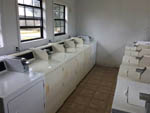 View larger image of Laundry room with washers and dryers at HILLTOP RV PARK image #5