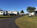 View larger image of Trailers parked at RV site with white and black truck at HILLTOP RV PARK image #9