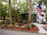 View larger image of Flag pole at campgrounds at NAPLES RV RESORT image #5