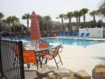 View larger image of Swimming pool with outdoor seating at OCALA SUN RV RESORT image #6