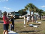 View larger image of Campers playing corn hole at OCALA SUN RV RESORT image #10
