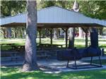View larger image of A covered pavilion with benches at LEISURE RESORT image #8