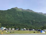 View larger image of RV sites with green mountains in back at EAGLES REST RV PARK  CABINS image #10