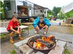 View larger image of Kids roasting marshmallows at LAKE GEORGE ESCAPE CAMPING RESORT image #5