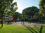 View larger image of Playground with swing set at GORDON HOWE CAMPGROUND image #3