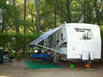 View larger image of Northern Pride RV unit with landscaped campsite at GORDON HOWE CAMPGROUND image #4