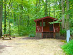 View larger image of Cabin with deck and picnic table at FOUR SEASONS FAMILY CAMPGROUND image #6