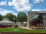 View larger image of Playground with swing set at DAKOTA RIDGE RV RESORT image #8