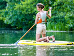 View larger image of Girl paddle boarding at KERRVILLE CONVENTION  VISITORS BUREAU image #4