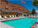 View larger image of Swimming pool with outdoor seating at MOAB VALLEY RV RESORT image #1