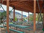 View larger image of Patio area with picnic tables at MOAB VALLEY RV RESORT image #8
