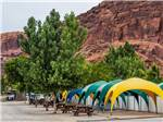 View larger image of Picnic tables and tents at MOAB VALLEY RV RESORT image #9