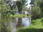 View larger image of RVs and trailers camping on the water at BAYFIELD RIVERSIDE RV PARK image #3