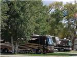View larger image of Large RV units parked along one another at BAYFIELD RIVERSIDE RV PARK image #4