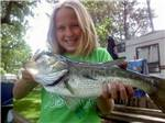 View larger image of Girl with fish at LEHMANS LAKESIDE RV RESORT image #6