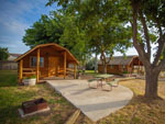 View larger image of Log cabins with decks and picnic tables at VISALIA SEQUOIA NATIONAL PARK KOA image #6