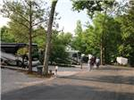 View larger image of Campers conversing in group beside RV at CAMPGROUND AT BARNES CROSSING image #9