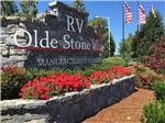 View larger image of Sign at entrance to RV park at OLDE STONE VILLAGE RV PARK image #1