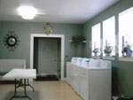 View larger image of Laundry room with washers and dryers at PINE CREST RV PARK OF NEW ORLEANS image #10