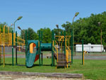 View larger image of Playground with swing set at BAYOU WILDERNESS RV RESORT image #2