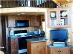 View larger image of Kitchen area inside cabin at BOULDER CREEK RV RESORT image #10