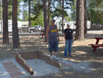 View larger image of Couple playing horseshoes at PIONEER RV PARK image #7